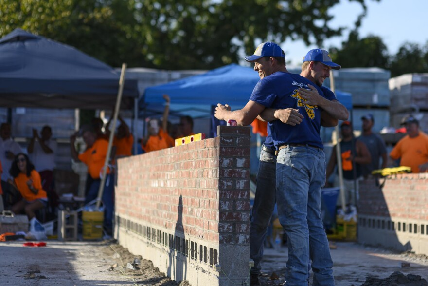 Jake and J.T. Payne hug after winning first place in the regional Bricklayer 500 competition for the second year in a row on September 12, 2019.