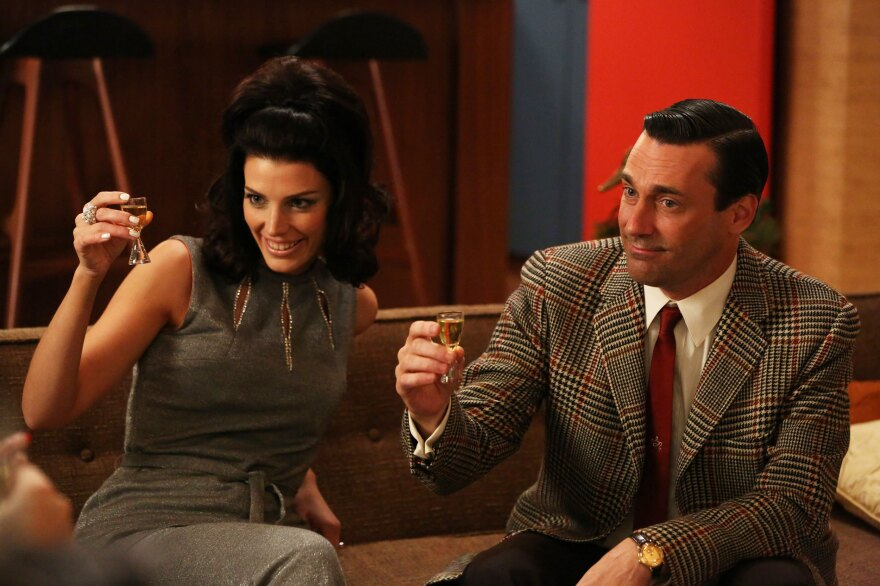 Megan Draper (Jessica Pare) and Don Draper (Jon Hamm) in an episode of <em>Mad Men</em>'s sixth season.