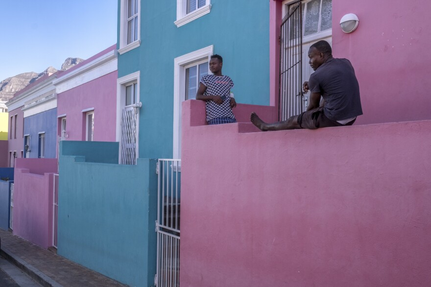 Young men pass the time on their front porch in Bo Kaap, a predominantly Muslim area of central Cape Town and a popular tourist site. Out of work since the start of South Africa's coronavirus lockdown, the men say they are worried that their savings will not last much longer.
