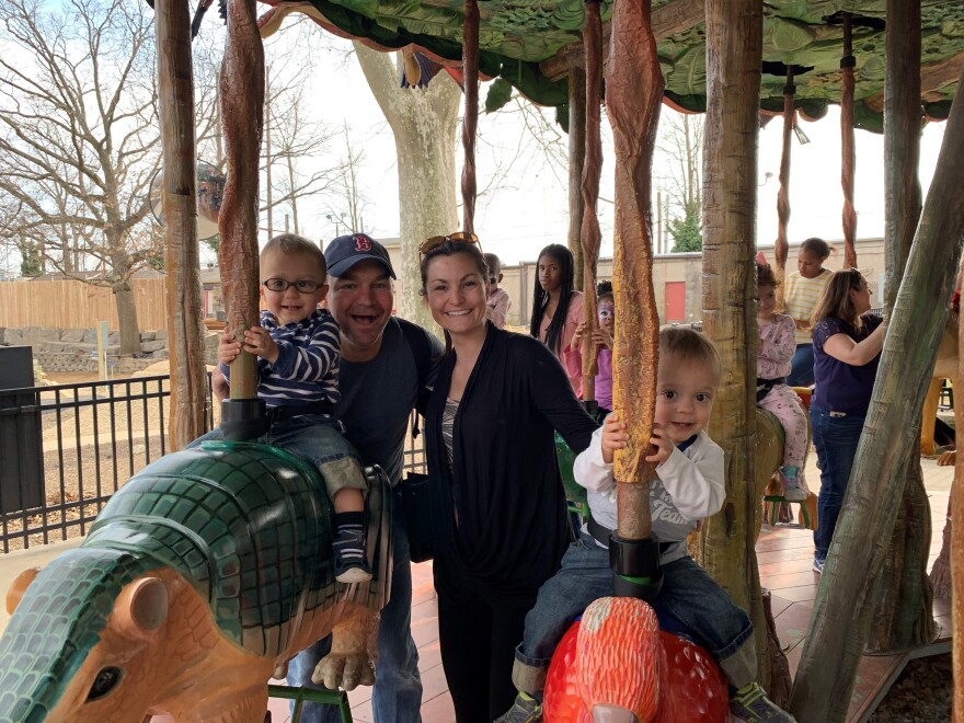 Long before the COVID-19 pandemic, Dr. Lauren Jenkins, her husband, Jay Roux, and their twins, Pierce and Ashton, ride the carousel at the Philadelphia Zoo.