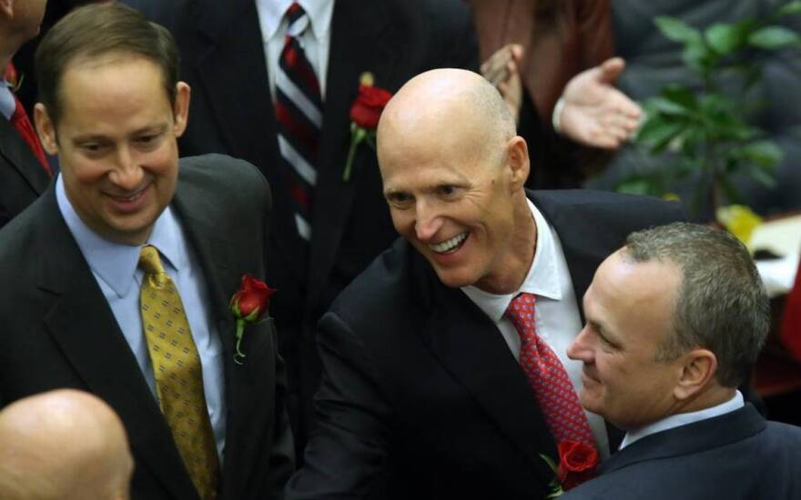 """From left: Senate President Joe Negron, Gov. Rick Scott and House Speaker Richard Corcoran. The leaders of the Legislature are far apart on proposals for higher education funding but say it's just a """"routine"""" part of the budget process."""