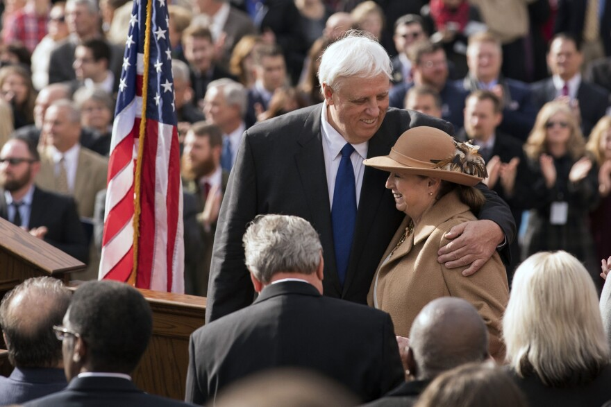 West Virginia Gov. Jim Justice and his wife, Cathy, embrace during his inauguration ceremony in Charleston, W.Va., Monday, Jan. 16, 2017.