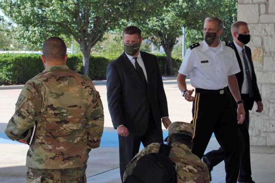 Secretary of the Army Ryan McCarthy, center, walks into the Killeen Civic and Conference Center on Aug. 6 ahead of a meeting with local officials in Killeen.