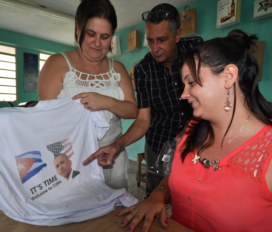 Future Cuban entrepreneur Mairene Valladares (right) with a Welcome, Obama T-shirt that she and her business-owner parents, Ruben (center) and Maida, printed up.
