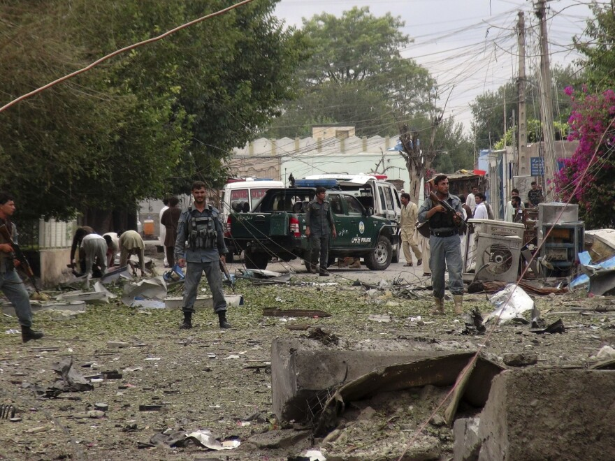 Security officials investigate the scene of an attack near the Indian consulate in the city of Jalalabad, Afghanistan, on Saturday.