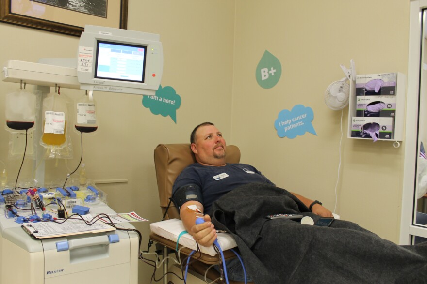 Swain Padgett donates his blood platelets recently in Leesburg.