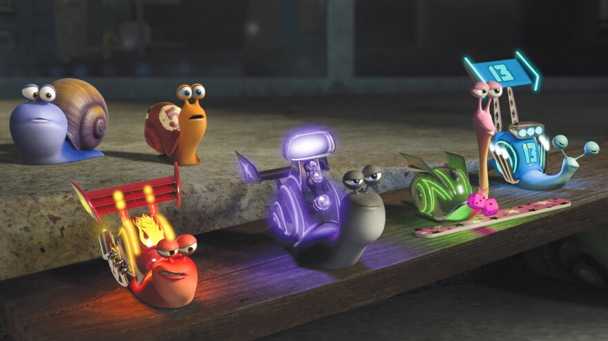 """Theo and his snail brother, Chet (back left), are referred to as """"garden snails"""" by veteran race snails, voiced by Samuel L. Jackson and Snoop Dogg."""