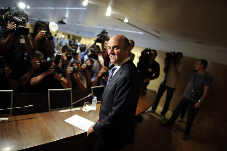 """""""The Spanish government states its intention to request European financing for the recapitalization of banks that need it,"""" Spanish Economy Minister Luis de Guindos said at a press conference on Saturday."""