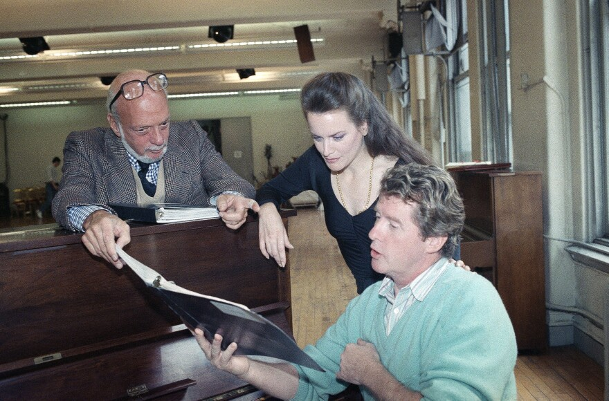 Hal Prince (left) works with Dale Kristien (center) and Michael Crawford in a rehearsal for <em>Phantom of the Opera</em> in April 1989.