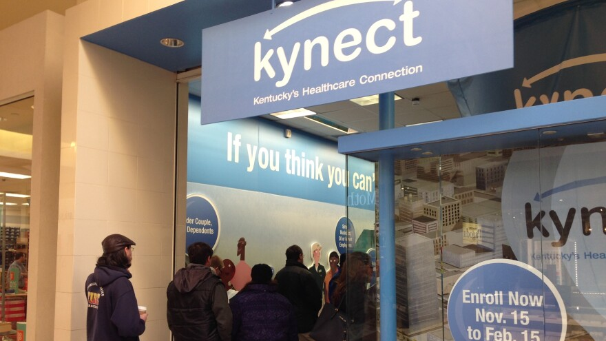 People line up outside the Kynect store at the Fayette Mall, in Lexington, Ky., in February to apply for health insurance through the state exchange.