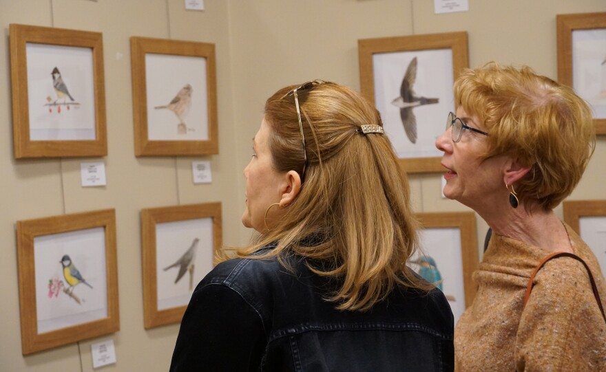Visitors to the Audubon Center at Riverlands on the opening night of their Wingspan art exhibition. The exhibit runs through the end of the month.