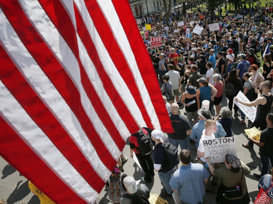 """Counterprotesters assemble at the Statehouse before a planned """"Free Speech"""" rally by conservative organizers begins on the adjacent Boston Common, on Saturday."""