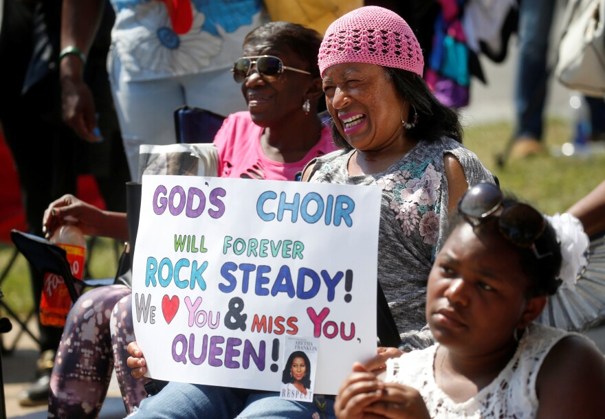 As loved ones and stars paid their respects to Franklin inside the Greater Grace Temple in Detroit, people gathered outside brought words of praise as well.