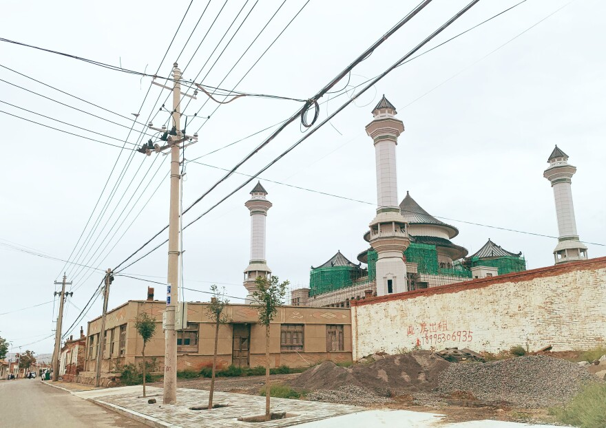 The domes and minarets of the Weizhou Grand Mosque in Ningxia have been replaced with tiled pagodas, NPR found in a visit this month to Weizhou.