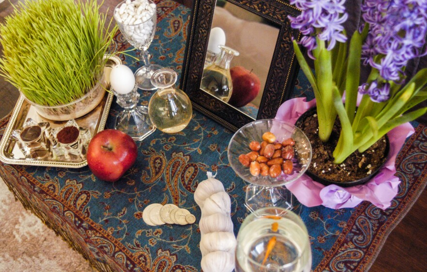 "Nowruz, the Persian New Year, is a celebration of the start of spring marked through large parts of the Middle East and Central Asia. Above, a Nowruz <em>haftseen</em> table, laden with <a href=""http://www.npr.org/sections/thesalt/2016/03/20/471174857/nowruz-persian-new-years-table-celebrates-spring-deliciously"">seven items</a> meant to symbolize rebirth or renewal."