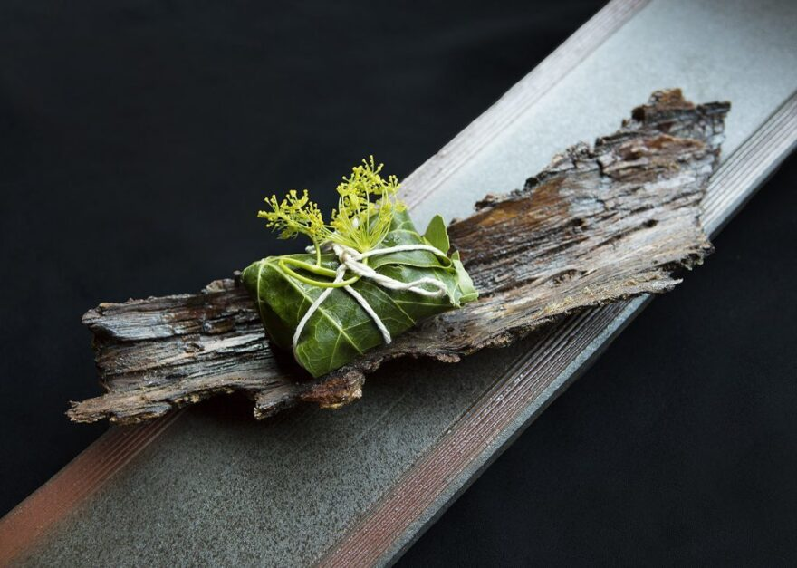 Greens served on a plate made of bark at N/Naka.