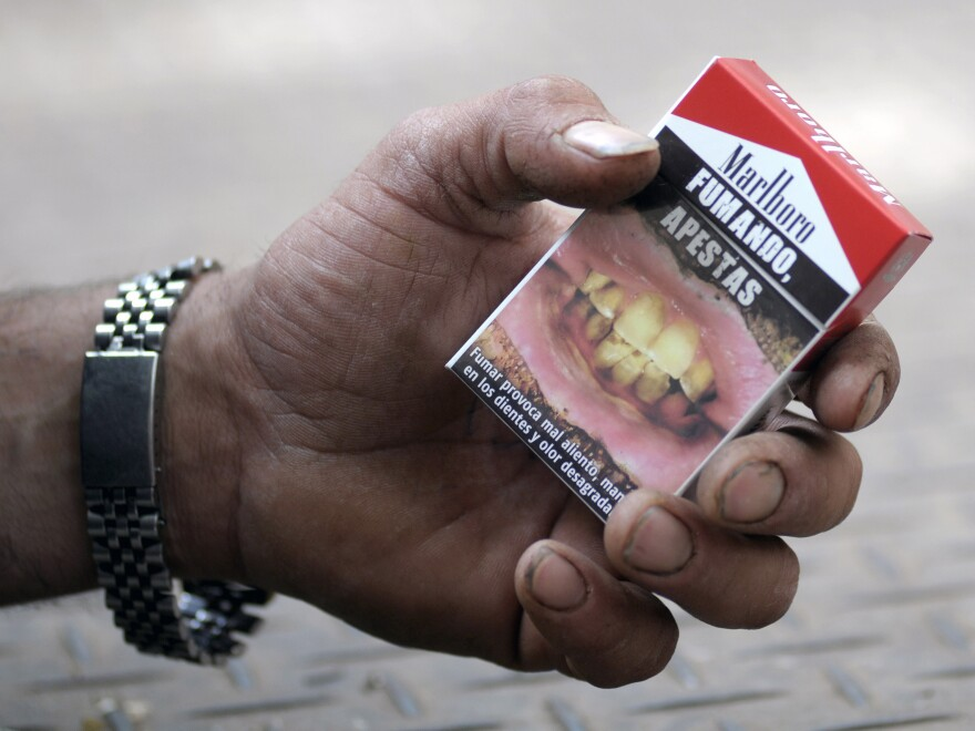 "<em>Fumando Apestas</em>: A cigarette package in Montevideo, Uruguay, warns that ""smoking, you stink."""