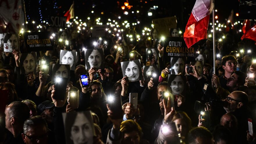Protesters bearing placards and photos of Caruana Galizia gather for a rally called by the journalist's family last week in Valletta, Malta.