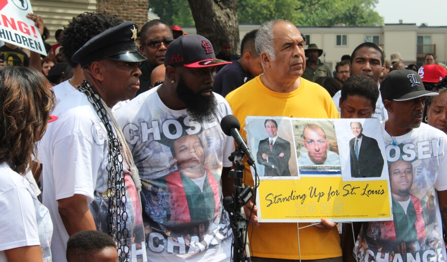 From left: Anthony Shahid, Brown Sr., and Zaki Barudi speak at the ceremony commemorating Michael Brown's death.