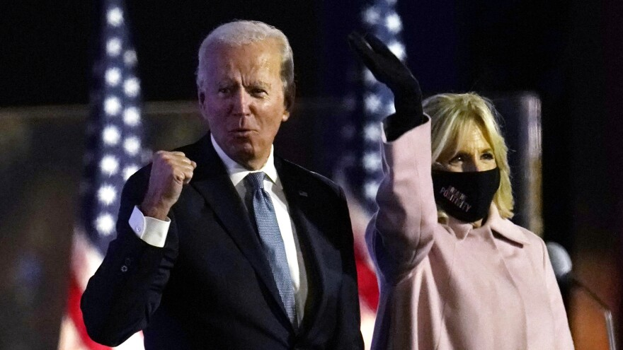 Democratic presidential candidate former Vice President Joe Biden speaks to supporters early Wednesday in Wilmington, Del., as his wife, Jill Biden, looks on.