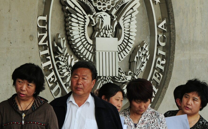 Chinese citizens wait to submit their visa applications at the U.S. Embassy in Beijing in 2012. Wait times for interviews once could stretch to a month or more.
