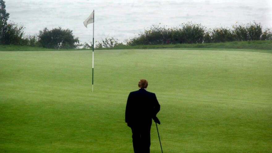 As part of a portrait session, Donald Trump walks toward the 11th tee on Trump National Golf Club Los Angeles in Rancho Palos Verdes, Calif.