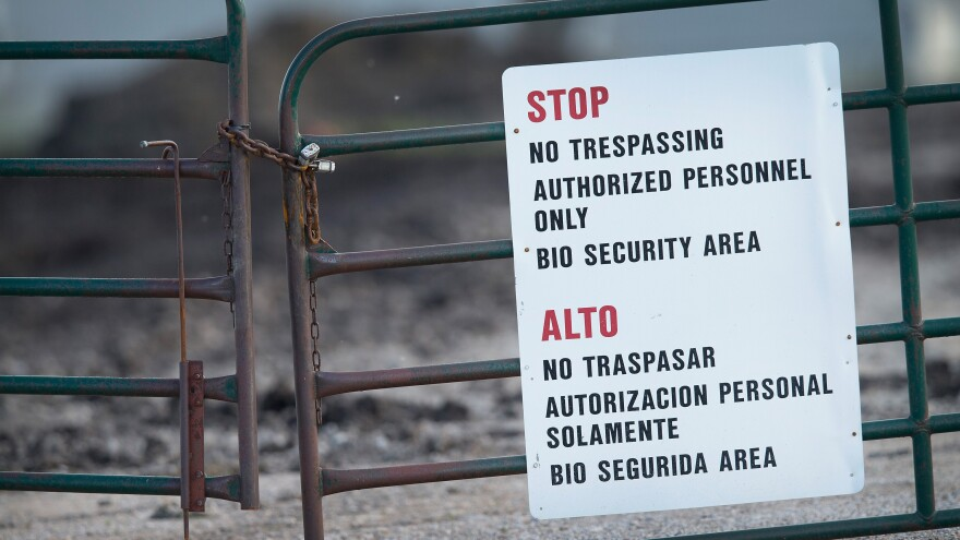 A gate blocks the entrance of a farm operated by Daybreak Foods, on May 17, 2015 near Eagle Grove, Iowa. The facility was reportedly struck by the current outbreak of bird flu. Secretary of Agriculture Tom Vilsick says biosecurity measures are crucial to containing the spread of the disease, which has only infected birds, not humans.