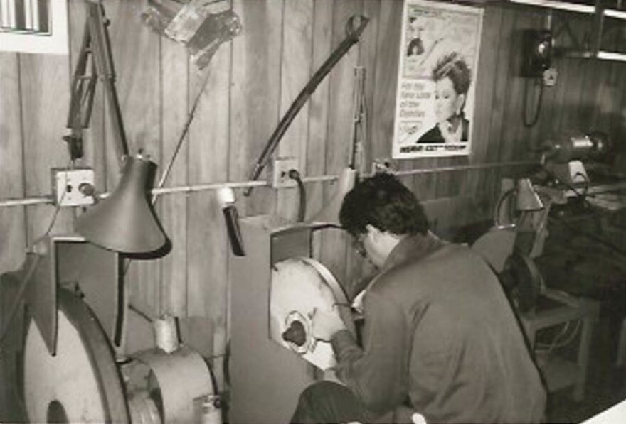 Joe Bianco works at the grinding wheel in the early years of his father's Brooklyn business.