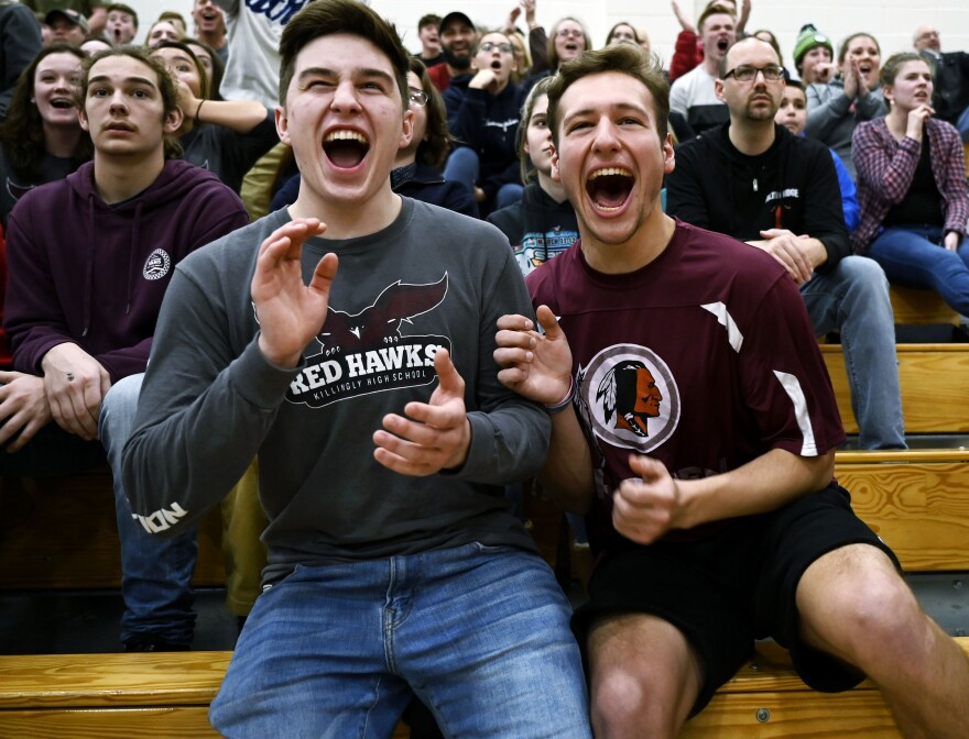 Senior Jacob Gilman, 18, wears a Red Hawks shirt while his friend, 18-year-old Josh Monty, wears a Redmen shirt during a Killingly High varsity basketball game on Jan. 11. Gilman says he wore the shirt mostly because he got it for free.