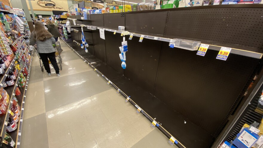 Shoppers found some empty shelves at a Kroger grocery store in Grosse Ile, Mich., on Friday. Americans are stocking up on food, toilet paper, water and other items amid the coronavirus outbreak.