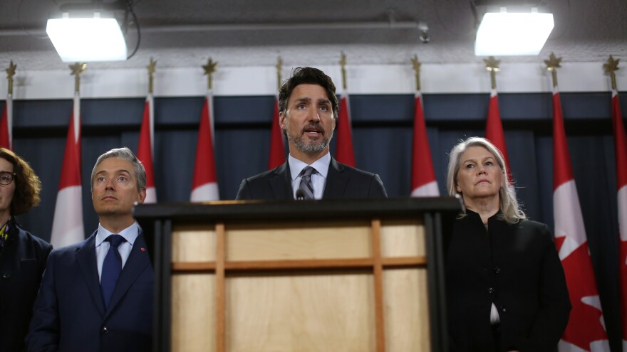 """Canadian Prime Minister Justin Trudeau addresses a news conference Saturday in Ottawa, flanked by high-level ministers. Trudeau called the Iranian admission a """"step forward,"""" but noted there are lots of questions still to be answered."""