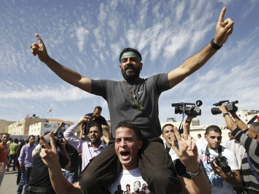 <p>Palestinians celebrate the release of prisoners in the West Bank city of Ramallah. A total of 477 Palestinians were freed Tuesday, with 550 more slated to be released in two months.</p>