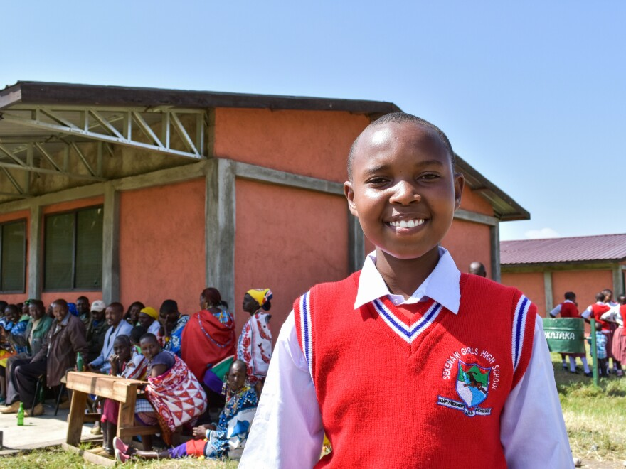 Faye, 14, a pupil at the school, proudly shows visitors the classrooms and grounds.