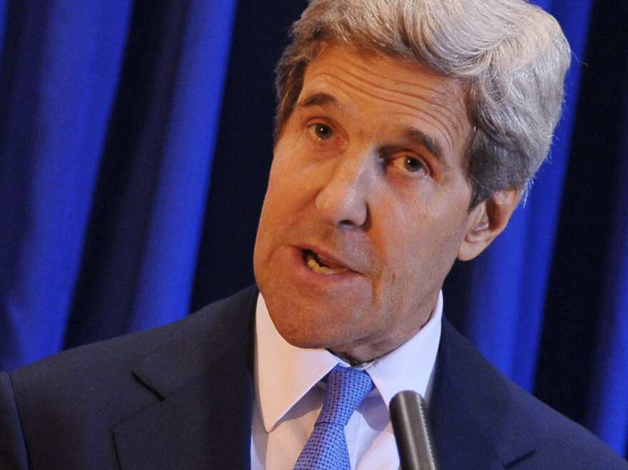 Secretary of State John Kerry speaks during a news  conference at Queen Alia International Airport in Amman on Friday.