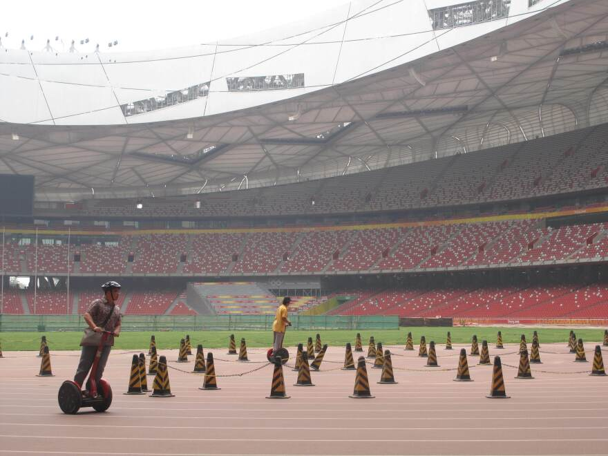 One money-making scheme has been to lease out Segways to tourists: $20 for a 15-minute ride around the Olympic track at the Bird's Nest.