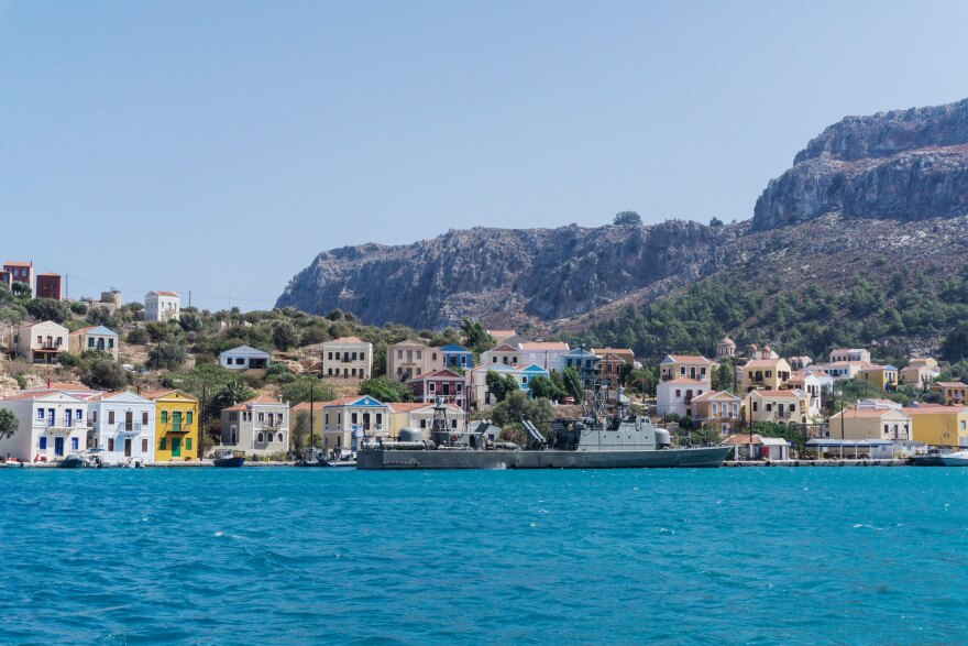 A Greek military ship is moored at the port of Kastellorizo.