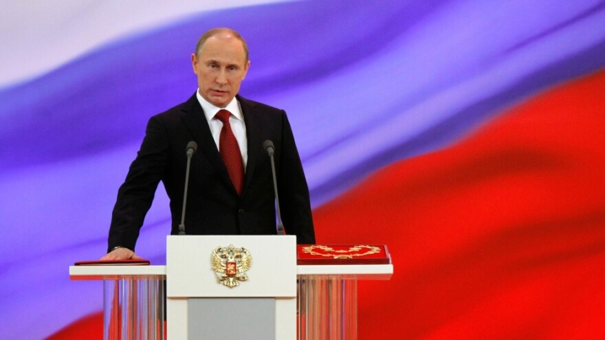 Vladimir Putin takes the oath of office during his inauguration as Russia's president at the Grand Kremlin Palace in Moscow on Monday. Putin will be serving his third term as president, after four years as prime minister and two previous presidential terms.