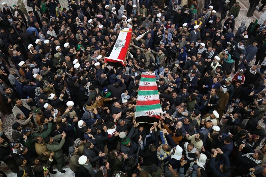 Mourners carry the coffins of Gen. Qassem Soleimani and Abu Mahdi al-Muhandis in Najaf, Iraq.