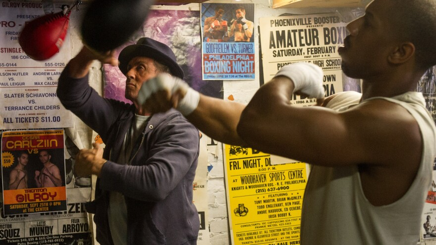Sylvester Stallone as Rocky Balboa and Michael B. Jordan as Adonis Johnson in a scene from <em>Creed</em>.