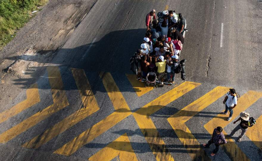 Migrants headed to the U.S. ride on a truck on the road from La Ventosa to Matias Romero, Oaxaca state, Mexico, on Thursday.