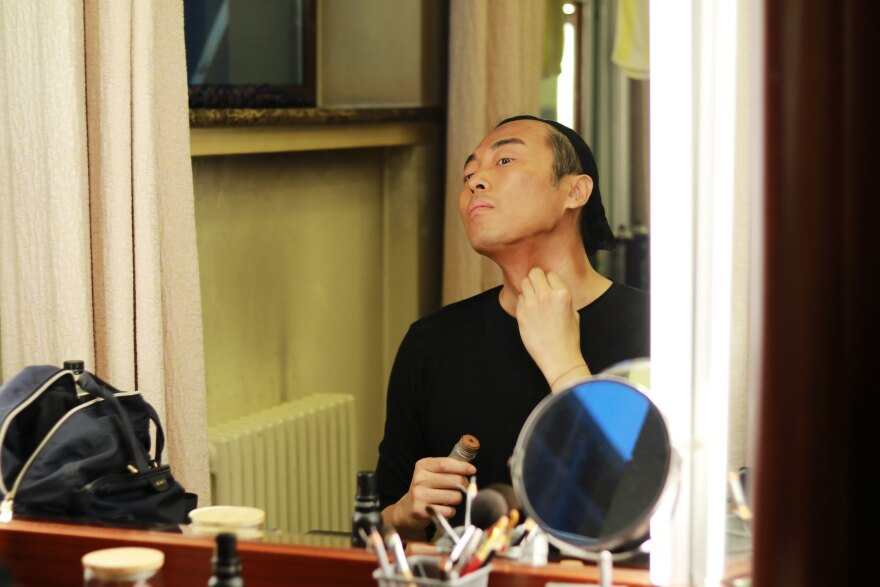 Actor Jin Han, who plays Walter Lee Younger, powders on dark stage make up on opening night of the production on Sept. 1.