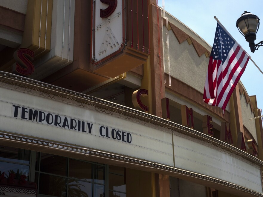 A movie theater is seen closed due to the coronavirus pandemic on July 2, 2020, in Brea, Calif. The U.S. economy shrank at a record 32.9% rate in the second quarter as the pandemic cost tens of millions of jobs.