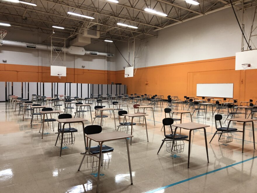 Desks are set up 6 feet apart in the gym at Navarro Middle School.