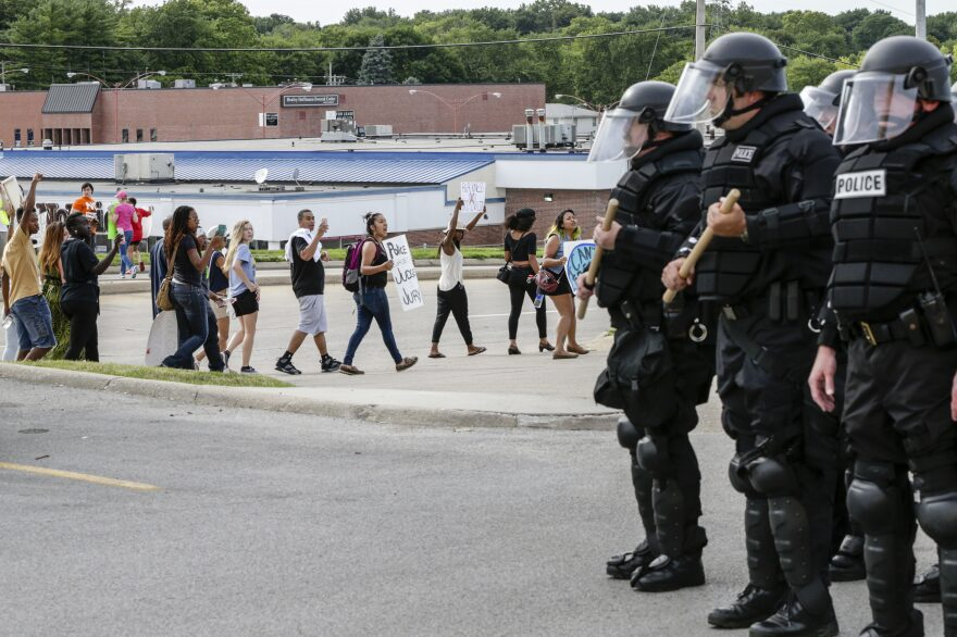 Police forces in riot gear keep watch on a demonstration in Omaha, Neb., on July 8. Participants were protesting the recent shooting death by police of Alton Sterling and Philando Castile.