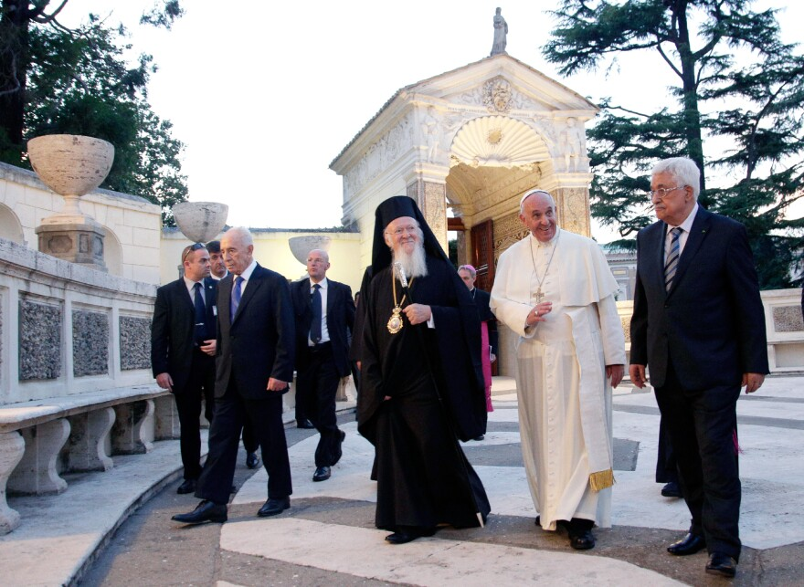 From left, Israel's President Shimon Peres, Ecumenical Patriarch Bartholomew I, Pope Francis and Palestinian President Mahmoud Abbas walk together at the end of an evening of peace prayers in the Vatican gardens in June.