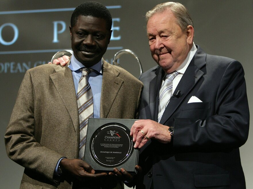 Pape Diouf, left, of French soccer team Marseille, receives an award from the Union of European Football Associations in 2005.