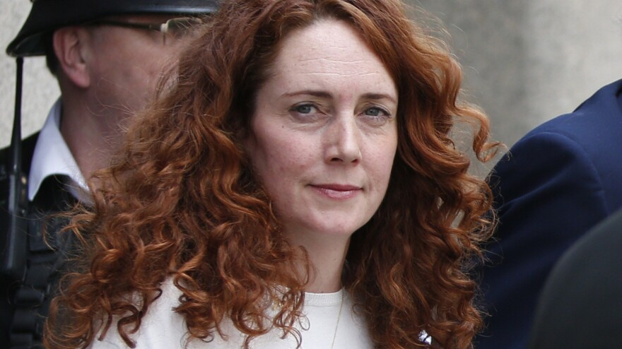 Rebekah Brooks, former News International chief executive, leaves the Central Criminal Court in London on Tuesday, after being acquitted. Former <em>News of the World</em> editor Andy Coulson was convicted of phone hacking Tuesday.