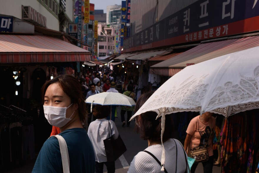 The outbreak of Middle East respiratory syndrome is slowing down in South Korea, but people were still wearing surgical masks around Seoul on Monday.