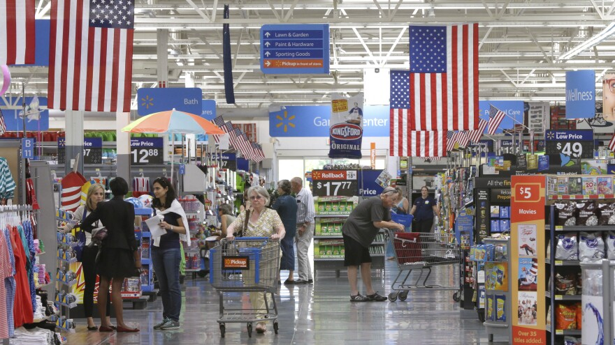 Customers shop at a Wal-Mart Supercenter store in Springdale, Ark., last summer.