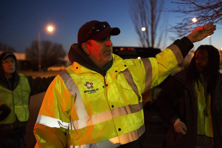 Rob Husmann explains cleaning procedures to crews. (Mardi Gras 2017)